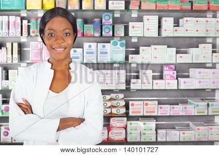 young friendly proud black pharmacist in pharmacy