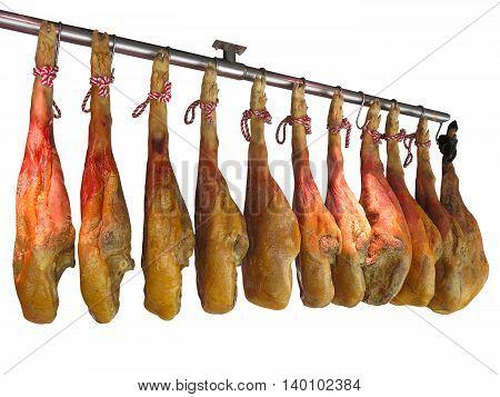 Spanish ham jamon hanging isolated on white background