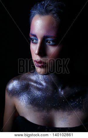 Beauty portrait of beautiful woman. cosmic girl, in motion