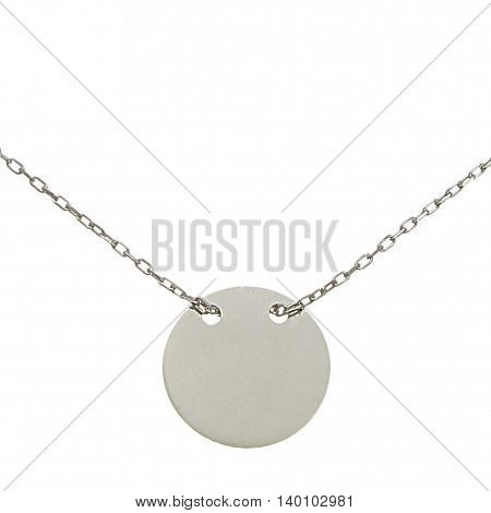 A silver chain with penny on white background