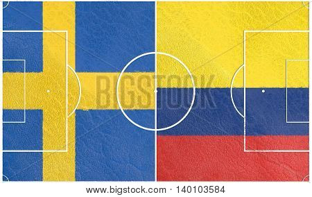 Flags of countries participating to the football tournament. Football field textured by Colombia and Sweden national flags. 3D rendering