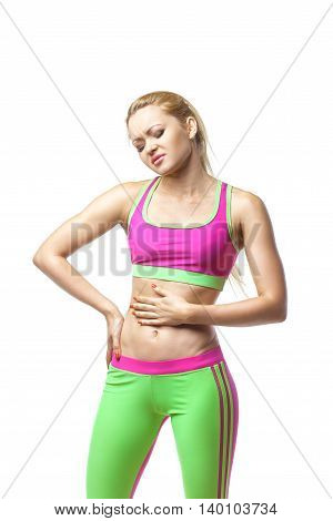 Stomach pain. Sport woman having abdominal pain, upset stomach or menstrual cramps. Pain in the abdomen, close-up over white isolated background
