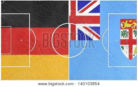 Flags of countries participating to the football tournament. Football field textured by Germany and Fiji national flags. 3D rendering