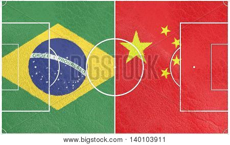 Flags of countries participating to the football tournament. Football field textured by China and Brazil national flags.3D rendering