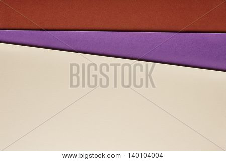 Colored cardboards background in beige purple red tone. Copy space. Horizontal