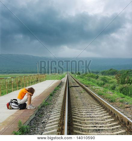 Young woman waiting train on station