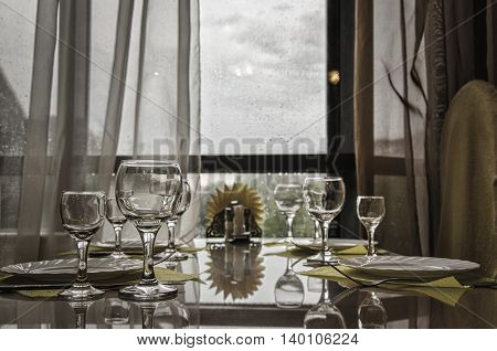Crystal-clear glasses on a dining table in a cafe