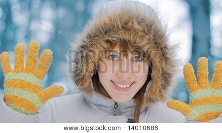 Young smiling woman in winter forest