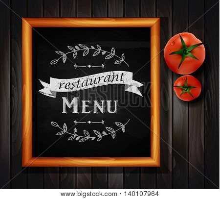 Menu on Chalkboard background with hand drawn ornament for restaurant in wooden frame on wooden background with two tomatos