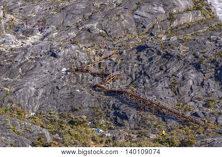 Ranau,Sabah Borneo-March 13,2016:Group of climbers move down to Laban Rata through new Ranau trail with wooden stairs.There are four mountain huts at Laban Rata,where most climbers spend the night en route to the summit