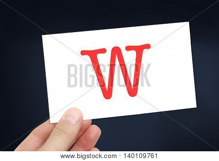The letter W on a card