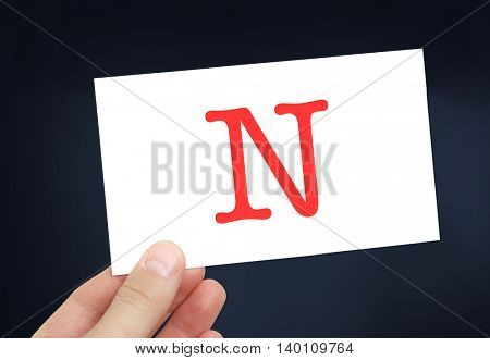 The letter N on a card