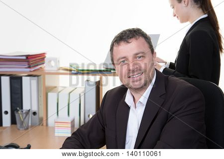 Mid Age Business Man Working  With A Woman In A Background