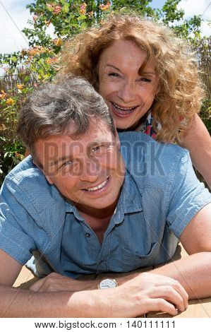 Lovers Outside Spend Good Time In Garden, Mid Aged Couple