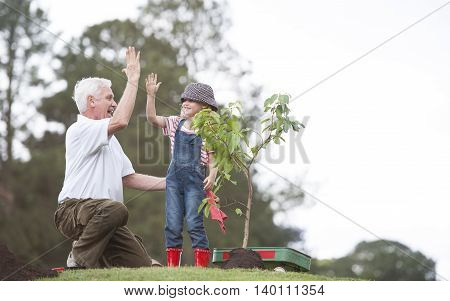 Planting Park Bonding Child Grandfather Family Togetherness Eco