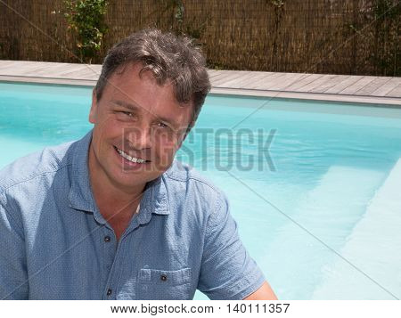 Handsome Man By The Pool, Looking At The Camera