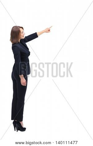 Sideview portrait of businesswoman pointing at something.