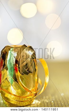 detail of golden ribbon on the unfocused background