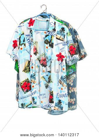The two isolated tropical shirts on white