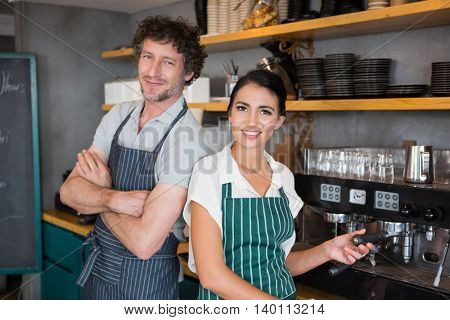 Portrait of waiter and waitress in cafeteria