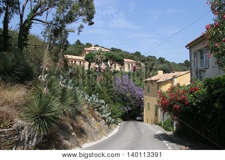 Road through ancient city Bormes-les-Mimosas in France