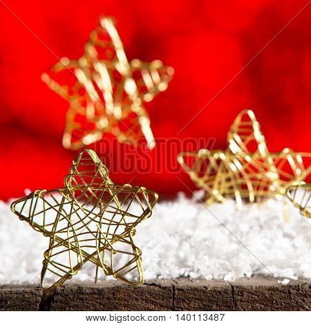 Golden Christmas stars on the red background