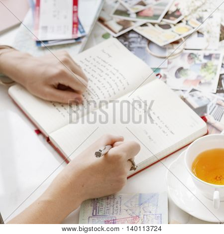 Writing Travel Diary Memories Photos Concept