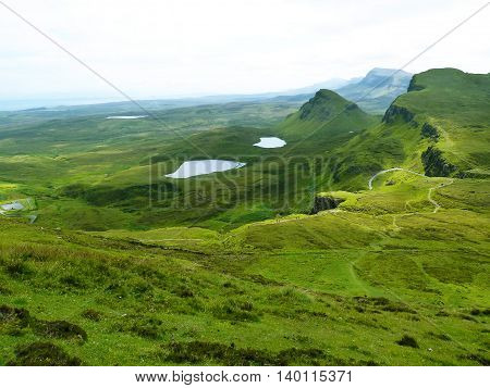 Rolling green hills and lakes on the Isle of Skye in Scotland.