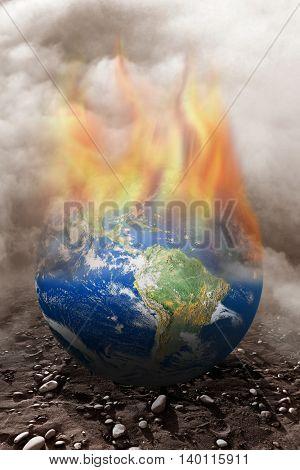 conceptual image of burning globe. Furnished NASA globe image used for this image.