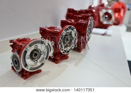 Gearbox on electric motor at industrial equipment plant