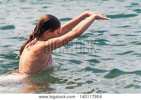 Young Girl Swimming In Ocean