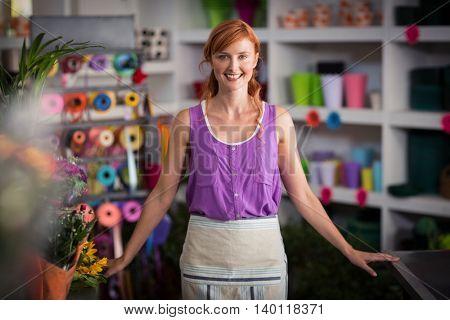 Portrait of female florist smiling in the flower shop