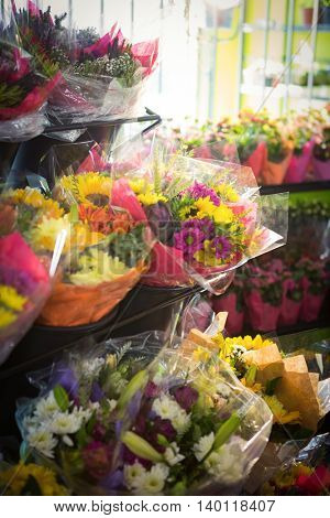 Bouquet of flower arranged on a flower shelf at his flower shop