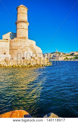 Saint Ioann's fort. The big watchtower is reflected in blue water of the Marseilles port