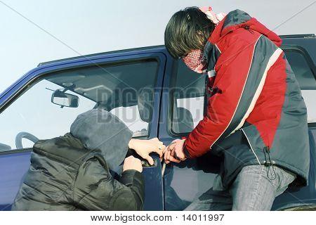 Two crime guys breaking car door