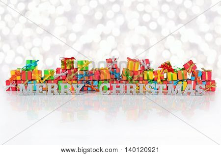 Merry Christmas Silver Text On The Background Of Varicolored Gifts