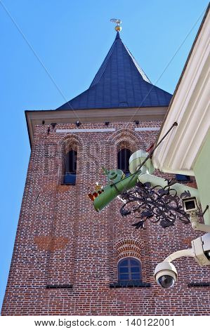 Tower of St. John´s Church in Tartu street surveillance cameras and dragonhead rainwater spout.