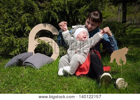 a happy mom with child play and laugh