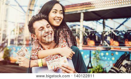 Teenage Couple Amusement Park Hugging Concept