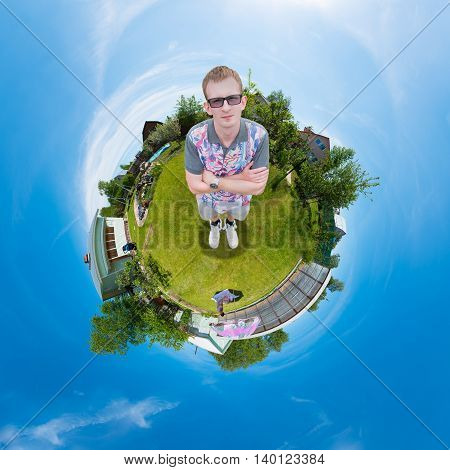 man standing on the grass in the garden, and the whole world is ball