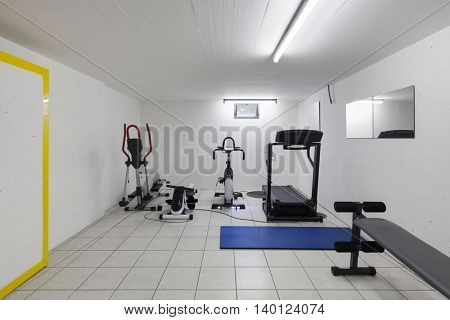 Interior of a house, garage with fitness equipment