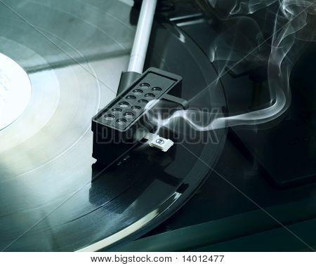 Broken retro vinyl player with smoke