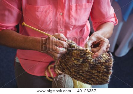 Senior woman knitting in a retirement home