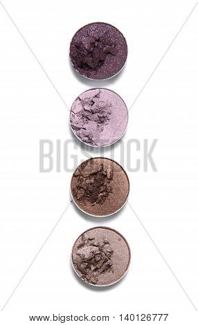 Crushed neutral and pink toned eye shadow make up pots isolated on a white background