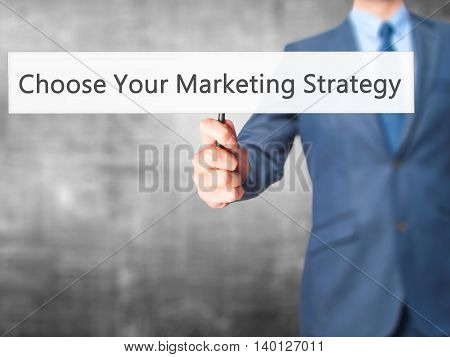 Choose Your Marketing Strategy - Businessman Hand Holding Sign