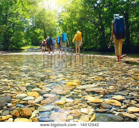 Group of backpackers fording cold