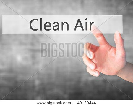 Clean Air - Hand Pressing A Button On Blurred Background Concept On Visual Screen.