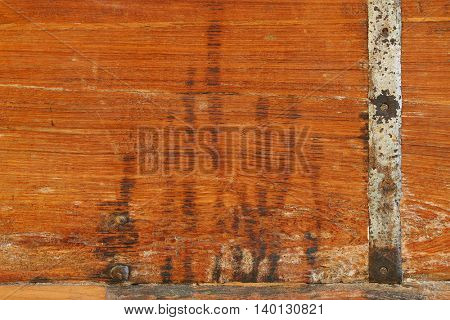 Background texture photo of rustic weathered wood with rusty metal bar