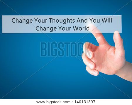 Change Your Thoughts And You Will Change Your World - Hand Pressing A Button On Blurred Background C