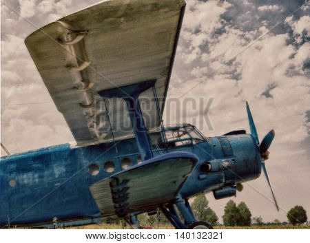 Biplane on the airfield in hdr effect. Summer. Side view.